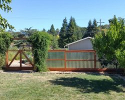 Corrugated fence with double gate in novato
